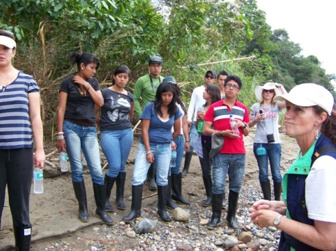 The group listens attentively (more or less) to Carlos's jungle trek instructions.