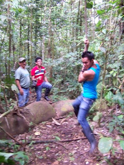 Jonathan gives his best Tarzan imitation as Carlos and Felix watch.