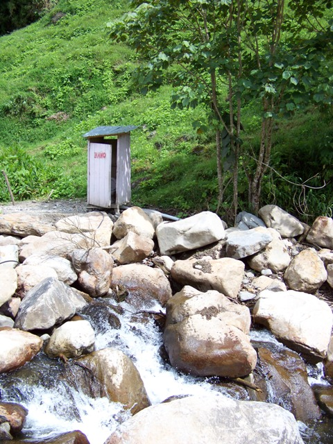 A little outhouse along a stream near Baeza with the discharge into the creek.