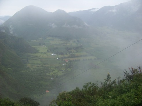 Pululahua crater in early morning fog.